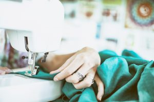 Person sewing on machine