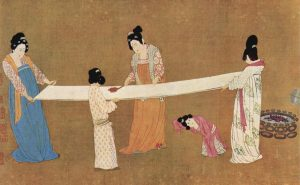 Woman making silk in the early 12th-century in China. Painting by Emperor Huizong of Song.