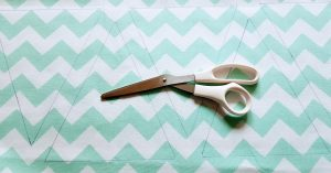 Draw your triangles on the folded fabric.