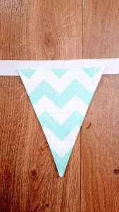 Place the triangle in the middle from the top of the ribbon.