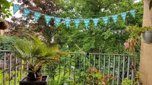 My balcony prepared for summer with the bunting decoration